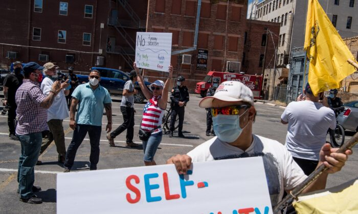 Protestors gather outside the El Paso County Court House during a rally calling for the reopening of El Paso and Texas in El Paso, Texas on April 25, 2020. (Cengiz Yar/Getty Images)