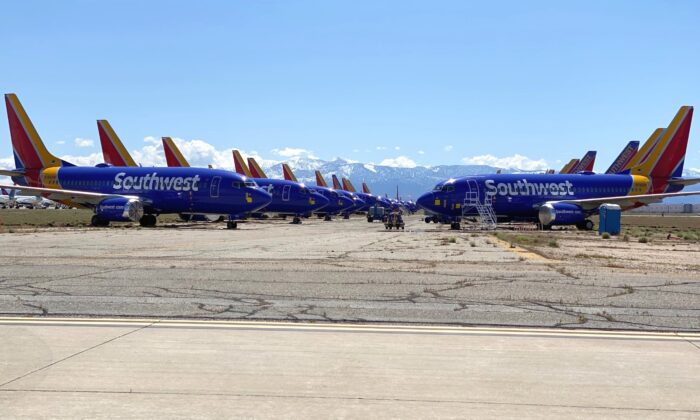 Aircraft parked at the Southern California Logistics Airport (SCLA) in Victorville, Calif., on April 11, 2020. SCLA is holding and maintaining many aircraft grounded due to the COVID-19 slowdown in travel. (Fred Fourcher)