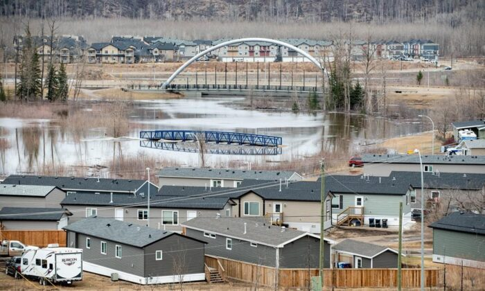 Flood water advances toward the Ptarmigan trailer court in the Waterways neighbourhood in Fort McMurray, Alta. on Sunday, April 26, 2020. (Greg Halinda/The Canadian Press)