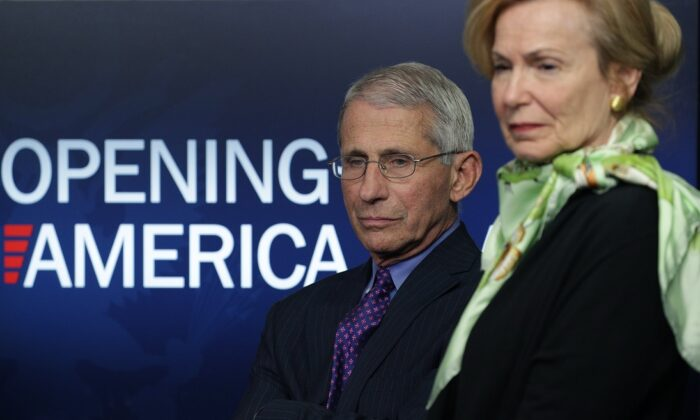 Dr. Anthony Fauci, director of the National Institute of Allergy and Infectious Diseases, and Deborah Brix, White House coronavirus response coordinator, listen to President Donald Trump speak at the daily briefing of the White House Coronavirus Task Force at the White House in Washington on April 16, 2020. (Alex Wong/Getty Images)