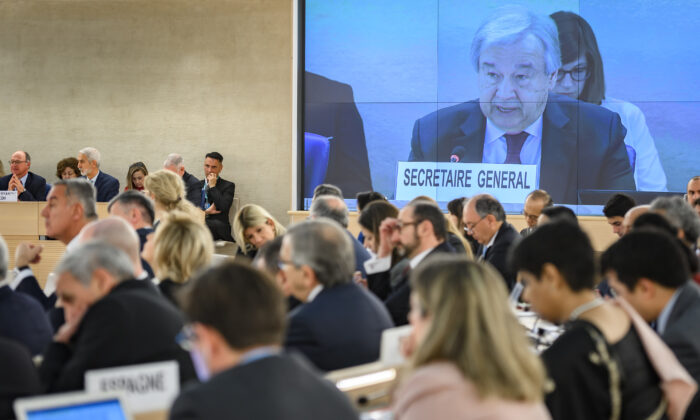 U.N. Secretary-General Antonio Guterres is seen on a giant screen addressing at the opening of the UN Human Rights Council's main annual session on Feb. 24, 2020 in Geneva. (Fabrice Coffrini/AFP via Getty Images)