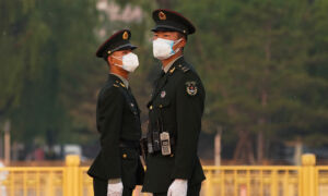 Beijing, on High Alert as Virus Spreads, Monitors Close Contacts of Those Infected