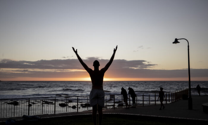 A person exercises at Bronte Beach on April 28 in Sydney, Australia, where social distancing rules are still in place.