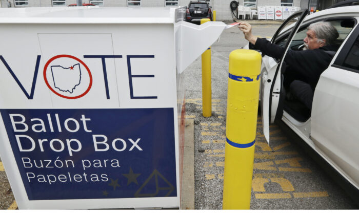 A man drops off his election ballot in the drop box at the Cuyahoga County Board of Elections, in Cleveland, Ohio, on April 22, 2020. (Tony Dejak/AP)