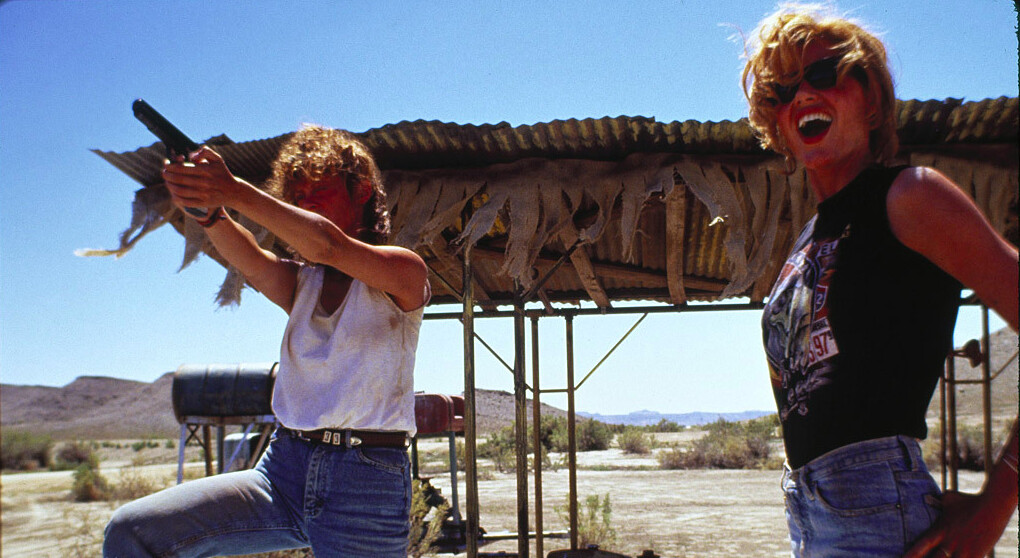 2 woman and a pistol