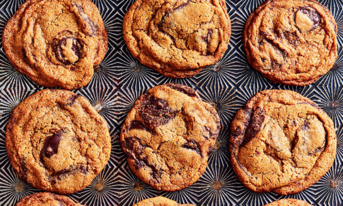 A soft-centered, caramelized-edged chocolate chip cookie, still warm and dappled with dark chocolate puddles, is instant comfort. (Julia Gartland)