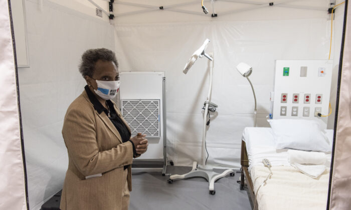 Chicago Mayor Lori Lightfoot tours the COVID-19 alternate care facility constructed at the McCormick Place convention center in Chicago, Illinois on April 17, 2020. (Tyler LaRiviere - Pool/Getty Images)