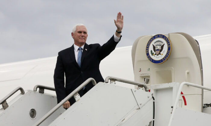 Vice President Mike Pence waves as he arrives for a visit to the Mayo Clinic in Rochester, Minn., on April 28, 2020. (Jim Mone/AP Photo)