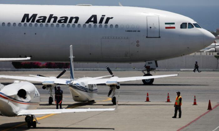 An Airbus A340-600 airplane of Mahan Air is seen at Simon Bolivar International Airport outside Caracas, Venezuela, on April 8, 2019. (Carlos Garcia Rawlins/Reuters)