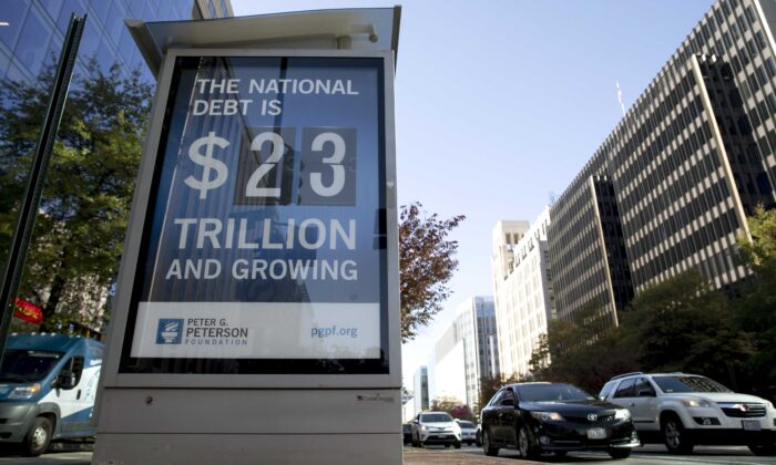 A sign showing the national debt is displayed in Washington, D.C., on Nov. 6, 2019. The current figure is almost $26.5 trillion. (Tasos Katopodis/Getty Images for PGPF)