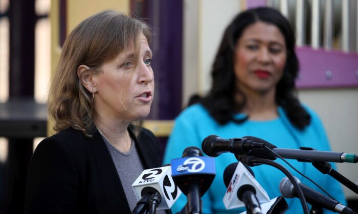 YouTube CEO Susan Wojcicki (L) speaks as San Francisco mayor London Breed (R) looks on during a press conference at Hamilton Families in San Francisco on Nov. 21, 2019. (Justin Sullivan/Getty Images)