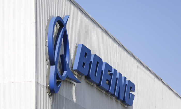 The Boeing logo is pictured at its Renton factory, where the Boeing 737 MAX airliners are built in Renton, Washington, on April 20, 2020. (Jason Redmond /AFP/Getty Images)
