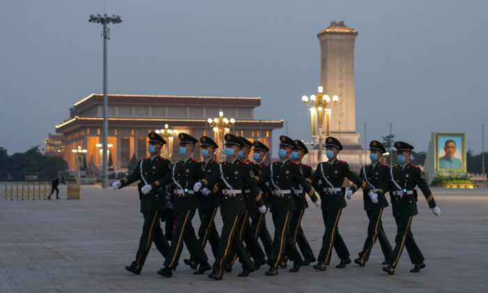 Chinese military soldiers march at Tiananmen Square in Beijing, China, on April 28, 2020. (Lintao Zhang/Getty Images)