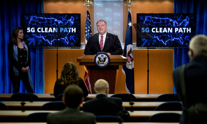 Secretary of State Mike Pompeo, accompanied by State Department spokeswoman Morgan Ortagus speaks at the State Department in Washington on April 29, 2020. (Andrew Harnik/Pool/AFP via Getty Images)