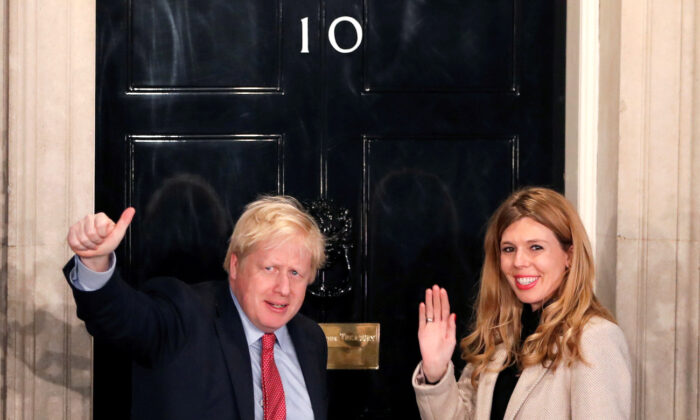 File photo of Britain's Prime Minister Boris Johnson and then-girlfriend Carrie Symonds gesture as they arrive at 10 Downing Street on the morning after the general election in London, Britain, on Dec. 13, 2019. (Reuters/Thomas Mukoya/File Photo)