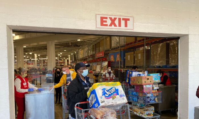 Shoppers wear masks as they get supplies at a Costco in Arlington, Virginia, on April 18, 2020. (Daniel Slim/AFP via Getty Images)