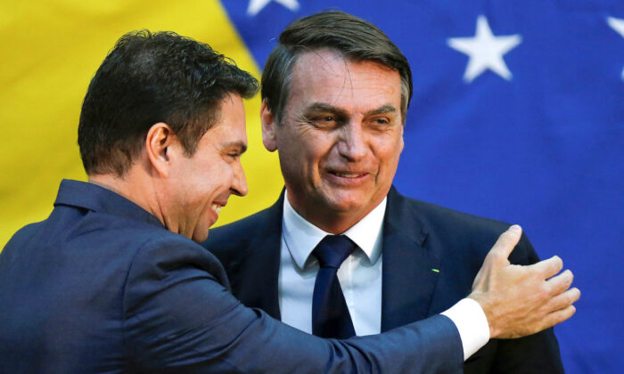 Brazil's President Jair Bolsonaro greets Alexandre Ramagem during his inauguration ceremony as the new general director of the Brazilian Intelligence Agency in Brasilia, Brazil, on July 11, 20109. (Reuters/Adriano Machado/File Photo)