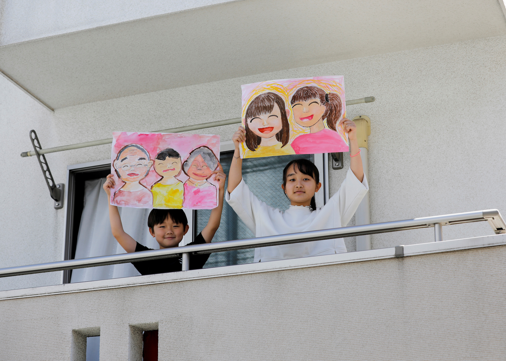 japanese children holding signs