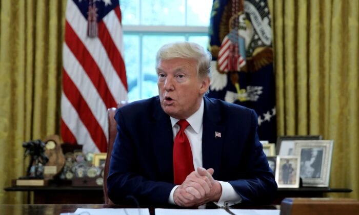 U.S. President Donald Trump answers questions during an interview with Reuters about China, COVID-19 pandemic, and other subjects in the Oval Office of the White House in Washington on April 29, 2020. (Carlos Barria)