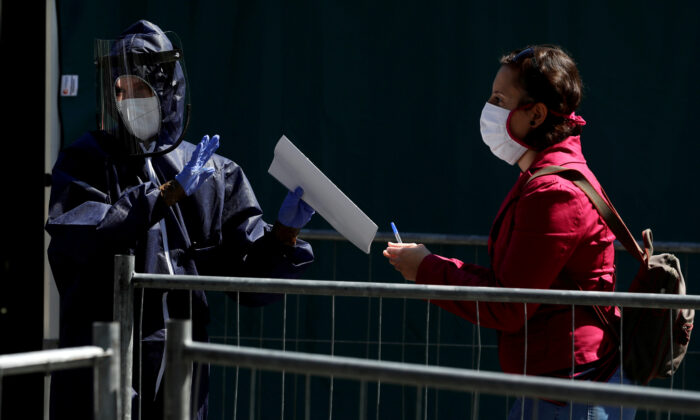 A medical worker gathers information from a woman that wants to get tested for the CCP virus disease (COVID-19) in Prague, Czech Republic, on April 23, 2020. The study investigated undetected infections of the CCP virus in the population. (David W Cerny/Reuters)