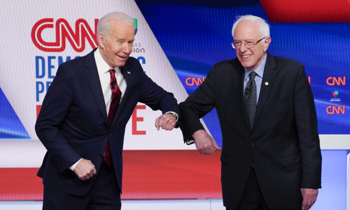 Democratic nominee Joe Biden (L) and Sen. Bernie Sanders (I-Vt.) greet each other before they participate in a Democratic presidential primary debate at CNN Studios in Washington on March 15, 2020. (Evan Vucci/AP Photo)