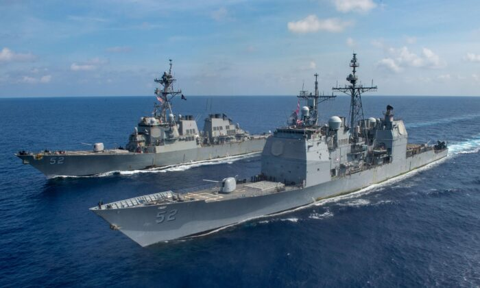 The guided missile cruiser USS Bunker Hill (CG 52), front, and the Arleigh Burke-class guided-missile destroyer USS Barry (DDG 52) transit the South China Sea. (Mass Communication Specialist 3rd Class Nicholas V. Huynh/U.S. Navy photo/Released)