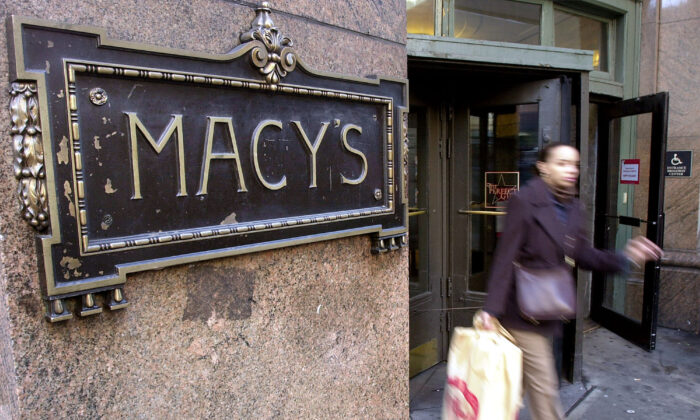 A woman exits Macy's department store on Sixth Avenue, in New York, on Dec. 14, 2000. (Chris Hondros/Newsmakers)