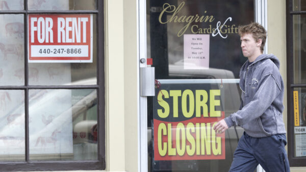 A man walks past a closed business