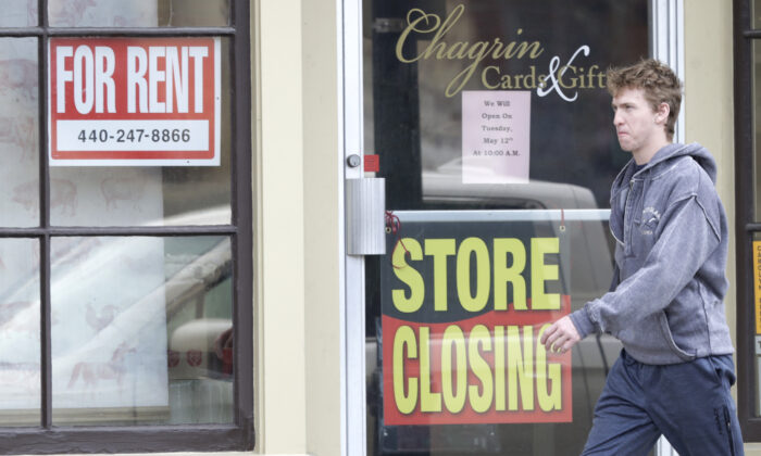 A man walks past a closed business in Chagrin Falls, Ohio, on April 29, 2020. (Tony Dejak/AP Photo)