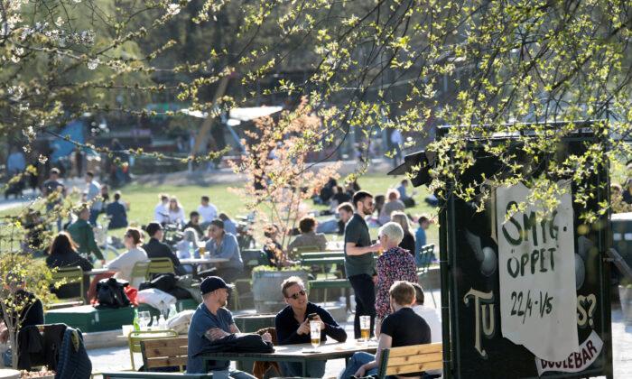 People socialize in Stockholm, Sweden, on April 22, 2020. (TT News Agency/Anders Wiklund via Reuters)