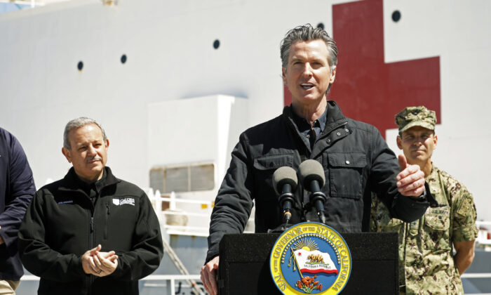 Californian Gov. Gavin Newsom speaks in front of the hospital ship USNS Mercy that arrived into the Port of Los Angeles on March 27, 2020. (Carolyn Cole-Pool/Getty Images)