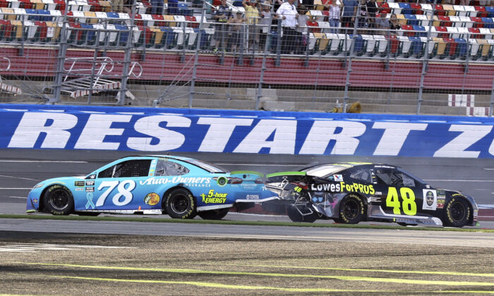 A NASCAR Cup series auto race at Charlotte Motor Speedway in Concord, North Carolina, on Sept. 30, 2018. (AP Photo/Chuck Burton, File)