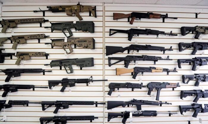 Semi-automatic rifles fill a wall at a gun shop in Lynnwood, Wash. (The Canadian Press/AP-Elaine Thompson)