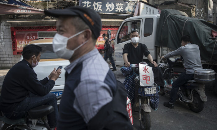 The migrant workers are waiting for work in the street in Wuhan, China on April 9, 2020. (Getty Images)