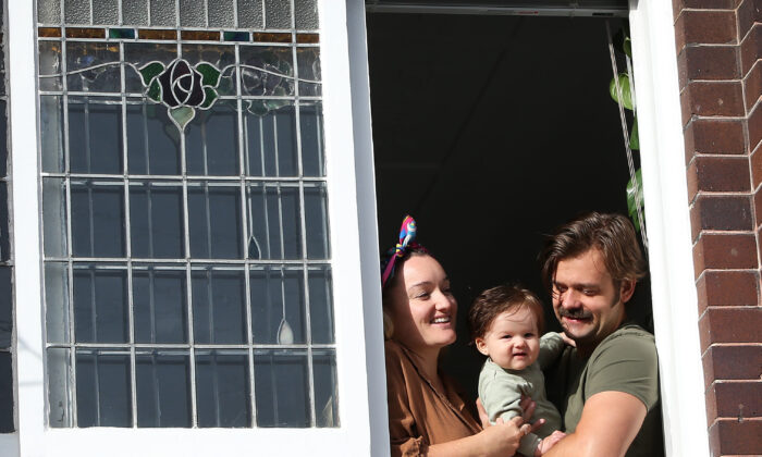 Laura Pike and partner Jordan Gallaway isolate with daughter Rumi, who was born during the bushfires, at their home in the Eastern Suburbs on April 20 in Sydney, Australia. (Lisa Maree Williams/Getty Images)