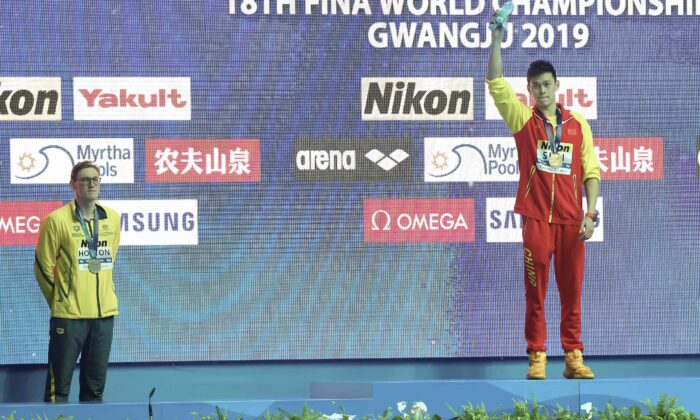 (L-R) Silver medalist Mack Horton of Australia and gold medalist Sun Yang of China pose during the medal ceremony for the Men's 400m Freestyle Final on day one of the Gwangju 2019 FINA World Championships at Nambu International Aquatics Centre in Gwangju, South Korea on July 21, 2019. (Maddie Meyer/Getty Images)