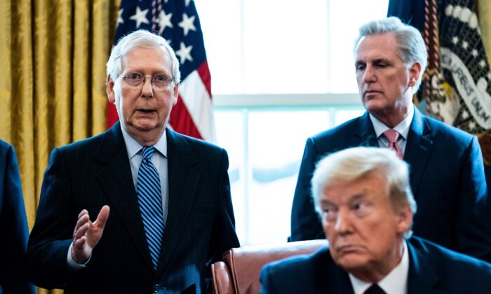Senate GOP Leader Mitch McConnell (R-Ky.) speaks as House Minority Leader Kevin McCarthy (R-Calif.) and then-President Donald Trump listen during a signing ceremony for H.R. 748, the CARES Act in the Oval Office of the White House in Washington on March 27, 2020. (Erin Schaff-Pool/Getty Images)