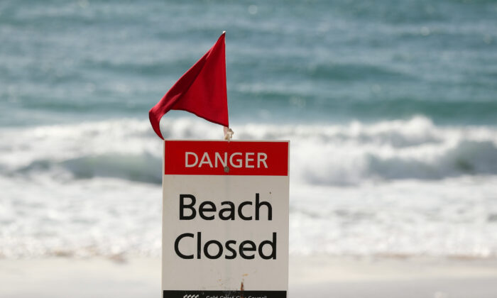 Beach Closed sign at Surfers Paradise beach on April 08, 2020 in Gold Coast, Australia. (Chris Hyde/Getty Images)