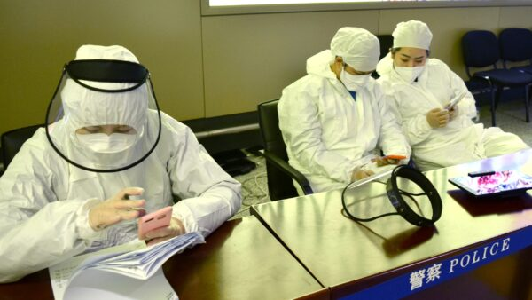 Workers in protective suits in Harbin