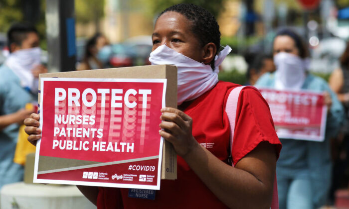 Nurses and supporters protest the lack of personal protective gear available at UCI Medical Center amid the CCP virus pandemic in Orange, Calif., on April 3, 2020. (Mario Tama/Getty Images)