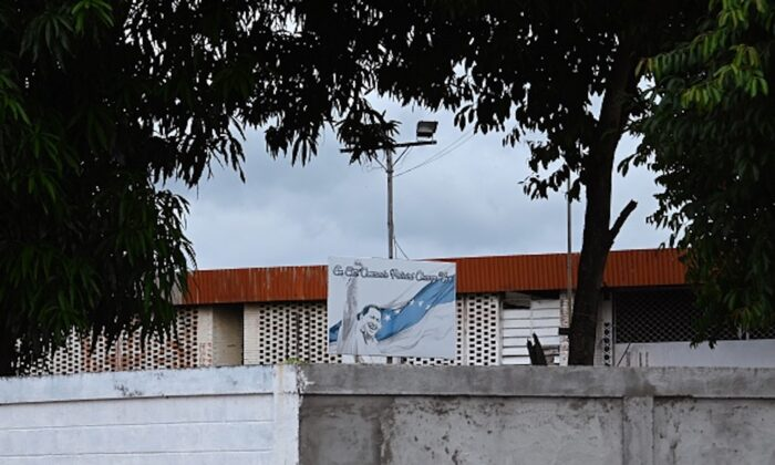 A billboard depicting late Venezuelan President Hugo Chavez is seen on May 25, 2019 on the roof of the police station jail where prisoners were killed during clashes on the eve, in the town of Acarigua, in the Venezuelan state of Portugues. (Marvin Recinos/AFP/Getty Images)