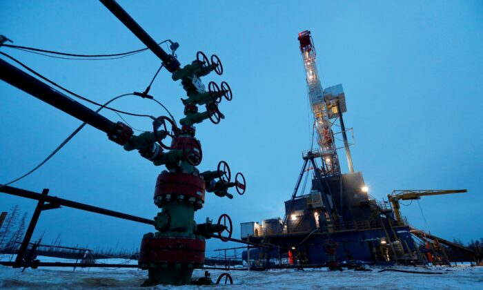 A well head and a drilling rig in the Yarakta Oil Field, owned by Irkutsk Oil Company (INK), in Irkutsk Region, Russia March 11, 2019. (Vasily Fedosenko/ Reuters)