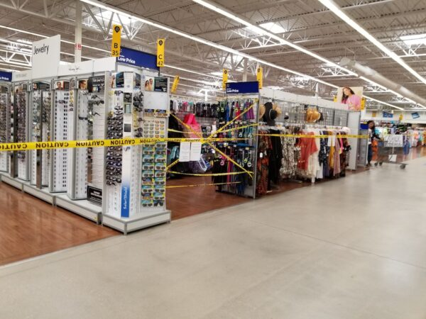 A yellow caution tape surrounds sections of merchandise at the Walmart