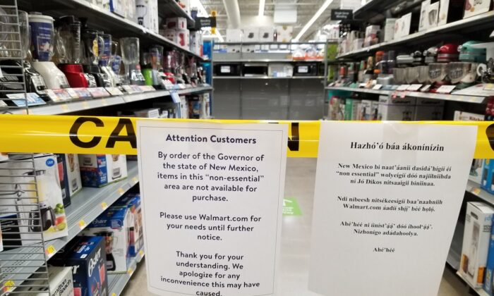A sign advises shoppers that non-essential items aren't available for purchase inside the Walmart in Gallup, N.M., on May 1, 2020. (Patrick Sandoval/AP)