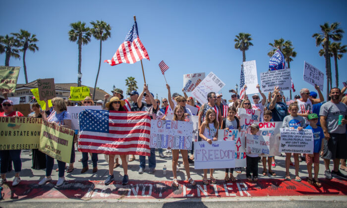 Protesters gather in a demonstration in Huntington Beach, Calif., on May 1, 2020. (Apu Gomes/Getty Images)