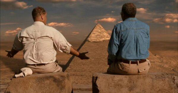 two men looking at pyramids