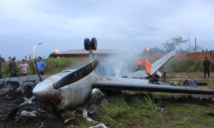 The wreckage of an Aerocon airlines Fairchild Metro 23 turboprop aircraft that crashed on landing in Riberalta, northern Bolivia, near the Brazilian border, leaving eight passengers dead and 10 injured, on Nov. 3, 2013. (Photo STR/AFP via Getty Images)