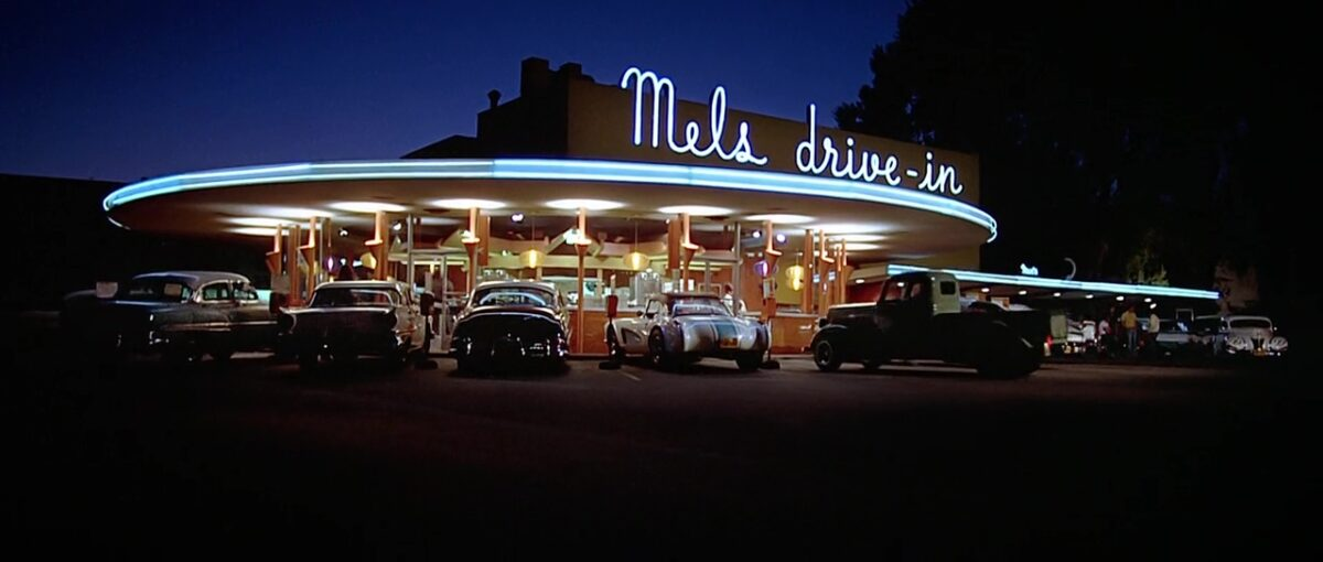 "diner in the evening with cars in ""American Graffiti"""