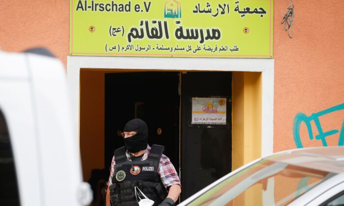 A police officer walks out of Al-Irschad Mosque during raids on mosques and associations linked to Hezbollah in Bremen, Berlin, in Germany on April 30, 2020. (ODD ANDERSEN/AFP via Getty Images)
