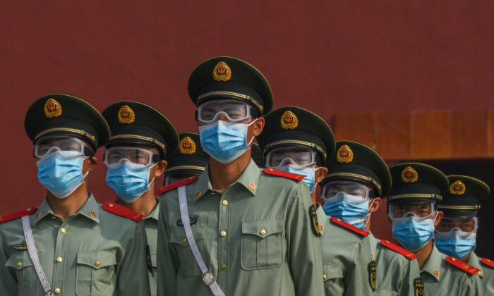 Chinese paramilitary police wear protective masks as they guard the entrance to the Forbidden City in Beijing on May 2, 2020. (Kevin Frayer/Getty Images)